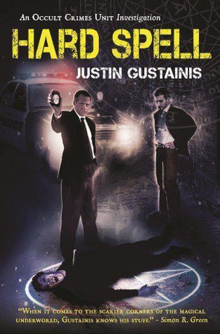 now reading Hard Spell by Justin Gustainis